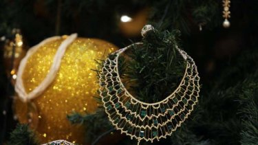 Jewellery decorates an $11m Christmas tree at the Emirates Palace hotel in the Emirati capital Abu Dhabi.