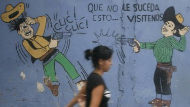 San Pedro Sula ... the graffiti reads, ''Hopefully, this will not happen to you.''