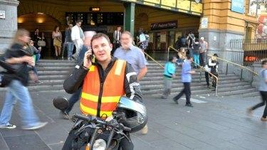 Drivers On Scoot owner Yan Flageul outside Flinders Street station.