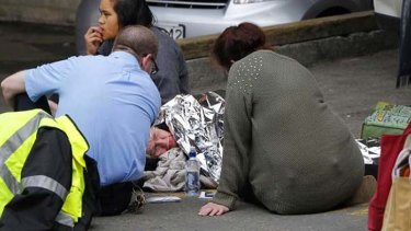 A woman is comforted in Wellington after an earthquake that struck New Zealand.