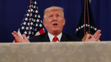 US President Donald Trump speaks to reporters after a security briefing at Trump National Golf Club in Bedminster, New Jersey.