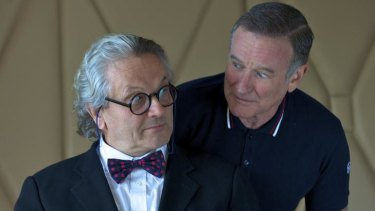 Dr George Miller with his Happy Feet voice star Robin Williams.
