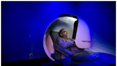 "Mahil Mohamed takes time out for a 20 minute nap in a ""sleep pod"" at the Virgin Active Gym on Collins Street,  Melbourne."