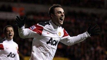 Dimitar Berbatov of Manchester United celebrates scoring his team's third goal.