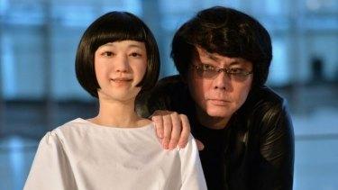 "Osaka University professor Hiroshi Ishiguro (right) with his creation ""Kodomoroid""."
