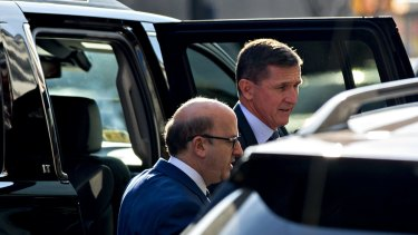 Michael Flynn, US national security advisor, right, exits a vehicle outside the US Courthouse in Washington, DC.