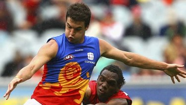 Another defeat ... Tom Rockliff kicks under pressure during the Lions' defeat to the Demons.