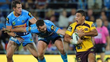 Man on a mission: Justin Hodges terrorised the Titans all night.