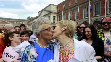 Same-sex marriage supporters kiss at Dublin Castle in Dublin.