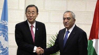 Palestinian Prime Minister Salam Fayyad (right) shakes hands with UN Secretary-General Ban Ki-moon.