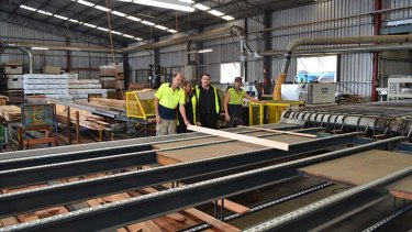 """Battling for survival"": Gary Hawtin, Lexie Hudson, Allan Hutley and Nathan Yates at the Australian Solar Timbers mill at Kempsey."