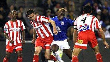 Everton's Louis Saha battles against the numbers last night.