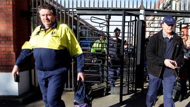 Slow down ... Ford workers leave the Geelong plant after being told some will lose their jobs.
