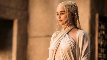 Pulling off the halter top ... Emilia Clarke as Daenerys  Targaryen.