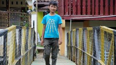 Afghan refugee boy Omid Jafary, 12, near his accommodation in Cisarua, Bogor, Indonesia.
