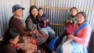 The Nepalese women who make the handicraft items. ladies making the craft items. <i>Photo: Rebecca Hallas</i>