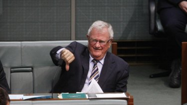 Wilson 'Ironbar' Tuckey held up a sign 'Where's da money, Mr Crook?'
