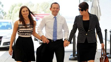 Tony Abbott yesterday with wife Margie, right, and daughter Frances.