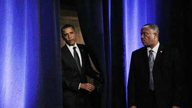 Barack Obama enters  the room at the Roosevelt Hotel to give his speech yesterday.