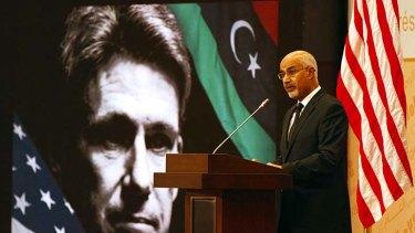 Tribute … in front of a portrait of Christopher Stevens, President Mohammed el-Megarif addresses a memorial service for the assassinated US ambassador.
