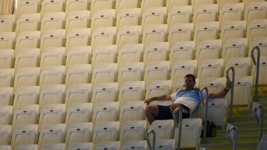Lonely ... a lone spectator watches the swimming.