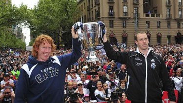 Cup in contention: Geelong captain Cameron Ling and Collingwood captain Nick Maxwell at the parade yesterday.