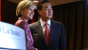 Australian Minister for Foreign Affairs Julie Bishop welcomes her Chinese counterpart Minister Wang Yi.