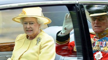 The Queen and the Duke of Edinburgh travel to Westminster Abbey for the royal wedding.