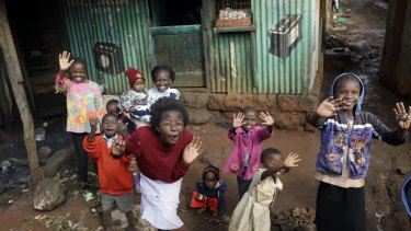 Children cheer and wave during Pope Francis' visit to the Kangemi slum, in Nairobi, Kenya.