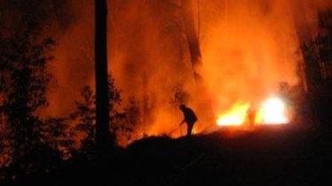 Firefighter battles a blaze in Gippsland earlier this month.
