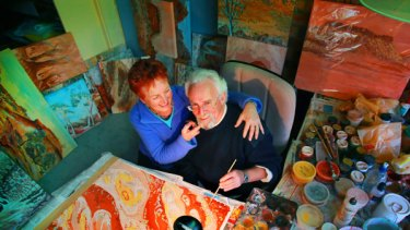 New perspective: Nick and Heather Safstrom with some of the paintings Nick has created since he lost the ability to communicate normally after a stroke eight years ago.