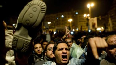 A protester waves his shoe in disgust after President Hosni Mubarak revealed he wasn't going to resign.