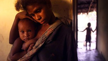 Then ... Fernanda Dos Santos with her daughter, Deolima, in 1999 when they were living in a refugee camp in the seaside town of Liquica.