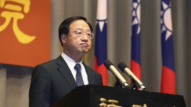 Taiwan's Premier Jiang Yi-huah announces he will step down after his ruling Nationalist Party was heavily defeated in local island-wide elections, Saturday, Nov. 29, 2014, at the Executive Yuan in Taipei, Taiwan.