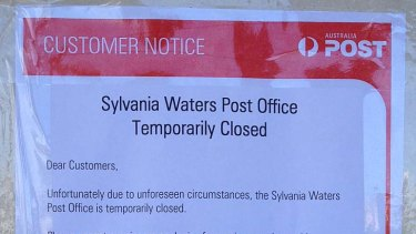 Closed ... a sign posted outside the post office today.