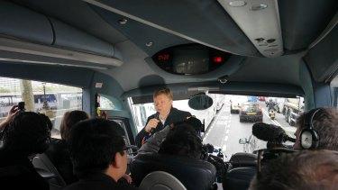 Borisovich conducts a bus tour.