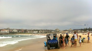 Bondi Lifeguards patrol the beach after swimmers were evacuated.