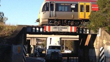 A truck stuck under a Goodna bridge.