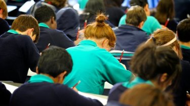 Pens down: students sit the NAPLAN test.