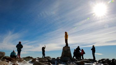 On top of Australia. Climbers at the summit of Mount Kosciuszko, 2228m above sea level.