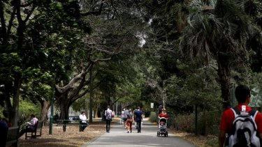 Visitors walk through the Brisbane Botanic Gardens.