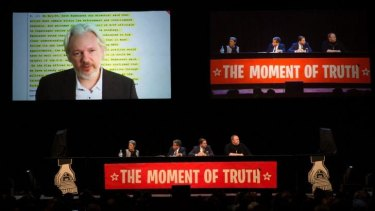 Julian Assange addresses the Auckland Town Hall meeting via video link. The meeting was also addressed by Edward Snowden.