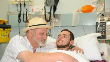 Richard Cass holds his son Jamie Neale after having earlier given him up for dead.