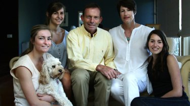 Federal Opposition Leader Tony Abbott with his family, from left,  Bridget, the family dog Maisie, Frances, wife Margie and Louise.