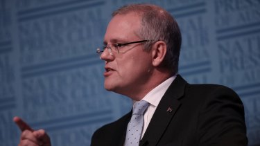 """Treasurer Scott Morrison, speaking at the National Press Club, said it was time for the banks to """"pony up"""" and absorb the tax."""