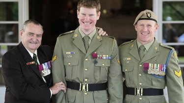 Heroes all ... Corporal Daniel Keighran VC is congratulated by WO2 (retired) Keith Payne VC, left, and SAS Corporal Mark Donaldson VC at Government House in Canberra on Thursday.