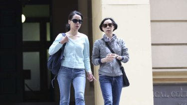 Robert Xie's wife, Kathy (left), and sister Xie Chu Ying leave Central Local Court on Wednesday.