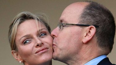 Awkward ... Prince Albert of Monaco kisses his new bride, Princess Charlene, during a meeting in South Africa.