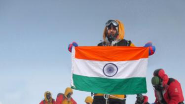 Tarkeshwari Rathod, in yellow gear, at the Everest summit.