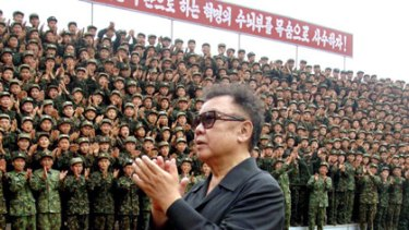 Flashback ... North Korean leader Kim Jong Il acknowledging applause from soldiers as he inspects the Korean People's Army Unit.